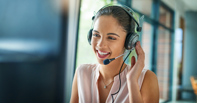 Contact Us - a woman using a telephone headset